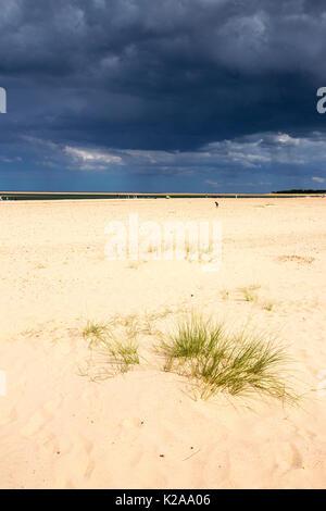 Dark storm clouds with rain over Holkham Beach, Norfolk, UK. - Stock Image