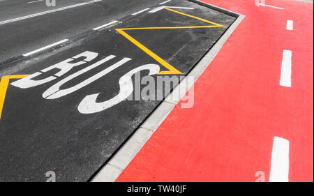 Painted bike, cycle path/lane next to bus stop in Spain. - Stock Image
