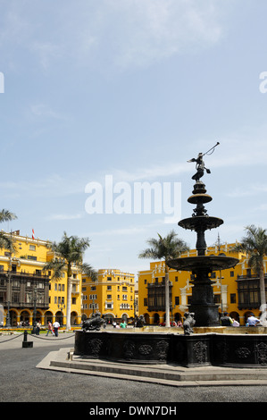 Bronze fountain with the statue of the Angel of Fame, Plaza Mayor, Lima, Peru - Stock Image