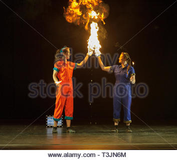 Edinburgh, UK. 10th April, 2019.  Aoife Raleigh in orange and Maria Corcoran demonstrate their skills with fire during the photo call for StrongWomen Science abrand-new circus science showat Edinburgh Science Festival starring two womenscientiststurned circus performers who reveal thescientific secretsbehind theirastounding tricks. Credit: Roger Gaisford/Alamy Live News - Stock Image