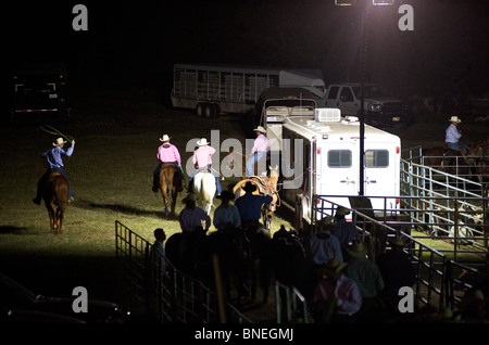 Cowboy members of PRCA riding horses backstage in Bridgeport  Texas, USA - Stock Image