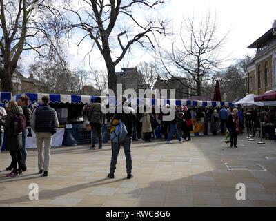 Busy market day in Duke of York Square, Chelsea, London, UK - Stock Image