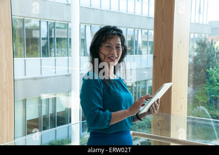 Asian woman in professional office or academic setting - Stock Image
