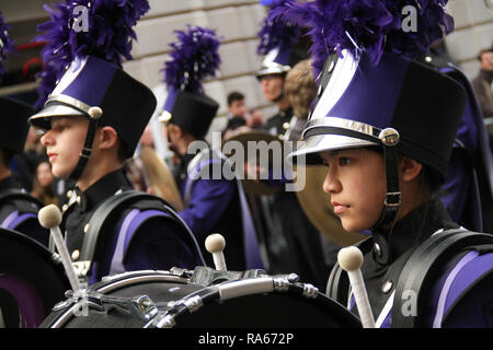 London, UK. 1st January, 2019. Members of the Trojan Marching Band from Downers grove, Illinois  ahead of the New  Year Parade. About 8,000 performers representing the London boroughs and over 20 countries from across the globe take part on the annual New Years Parade on the street of London. The parade run from Green Park Tube station to Parliament Square. Photo credit:  David Mbiyu/Alamy New Live - Stock Image