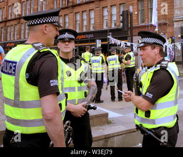 Glasgow, Scotland, UK 15th July, 2019. Extinction Rebellion Summer Uprising started with  Mondays planned stint as they took to the streets to block the centre of Glasgow with a purple boat along with actions in 4 other cites. Gerard Ferry/ Alamy Live News - Stock Image