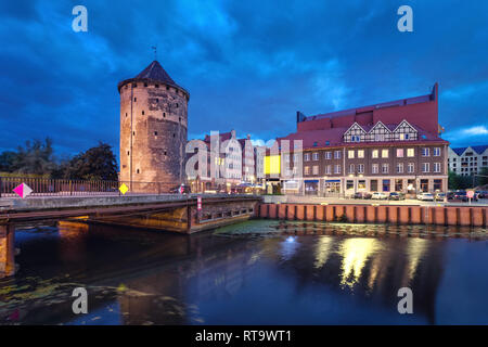 Historic Brama Stagiewna (Milk cans gate) in old town at night in Gdansk, Poland - Stock Image