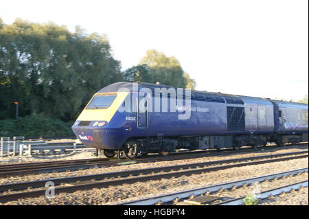 HST locomotive No.43024 departs Platform 3 of Swindon station in October 2016 branded in First Great Western livery. - Stock Image