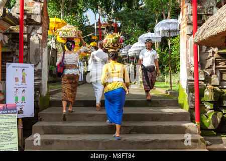 UBUD, INDONESIA - MARCH 2: Women walks up the stairs during the celebration before Nyepi (Balinese Day of Silence) - Stock Image