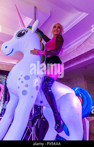 Skibbereen, West Cork, Ireland. 20th Oct, 2018. Pole Dancer Racheal Palmer from Galway performed a routine at the show. The show has been attended by many tattooists from across Ireland and the North. The event finishes tomorrow. Credit: Andy Gibson/Alamy Live News. - Stock Image