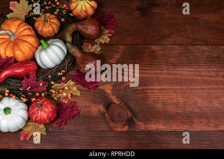 Thanksgiving decor with pumpkins, gourd, squash, maple leaves and berries - Stock Image