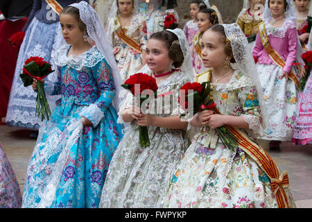 Children dressed in traditional costumes during procession at the annual offerings to the Lady of the Forsaken during - Stock Image