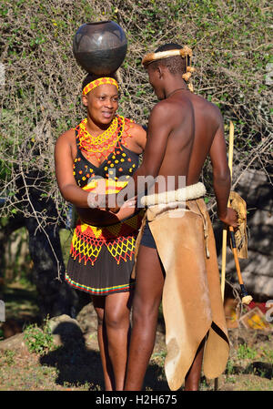 Shakaland Zulu troupe members poses in traditional clothes  re-enacting  a Zulu courtship at Shakaland Cultural - Stock Image