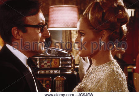 CASINO ROYALE (1967) Pictured:  Ursula Andress and Peter Sellers.  copyright Columbia Pictures.  Photo courtesy - Stock Image