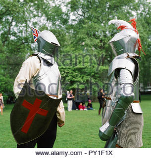 Medieval reenactors in their shining suits of body amour. London, UK. - Stock Image