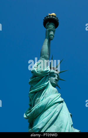The Statue of Liberty in New York Harbour on a summer day in the USA - Stock Image