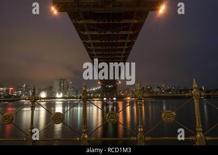 city and bridge at night - Stock Image