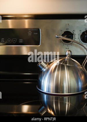 Kettle on a Stove Range - Stock Image