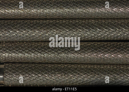 Macro-photo of shafts of a jeweller's screwdriver set. - Stock Image