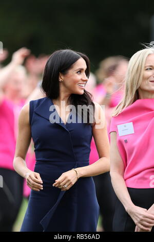 Prince Harry The Duke of Sussex with Meghan Markle the Duchess of Sussex on Day Three of their tour of Australia , the couple visited Government  house Melbourne to watch women take park in this girl can sporting event - Stock Image
