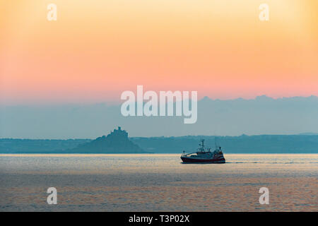 Newlyn, Cornwall, UK. 11th Apr, 2019. UK Weather. A chilly but glorious start to the day at Newlyn at sunrise. Seen here fishing boat from Newlyn. Credit: Simon Maycock/Alamy Live News - Stock Image