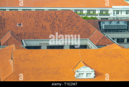 Terracotta tile rooftops of buildings. - Stock Image