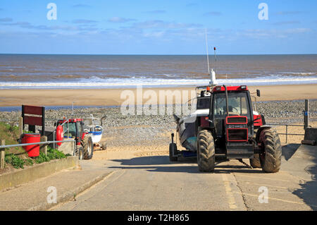 A view towards the beach and sea with local fishing boats on the North Norfolk coast at East Runton Gap, Norfolk, England, United Kingdom, Europe. - Stock Image