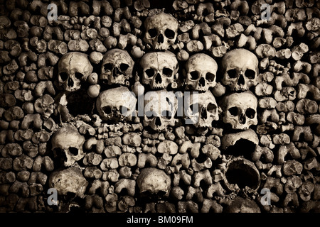 Close up of skulls in the Catacombs below Paris - Stock Image