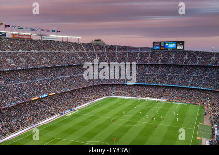 Camp Nou football stadium in Barcelona.Sunset is coloring clouds  making even better the overall view as we watch - Stock Image
