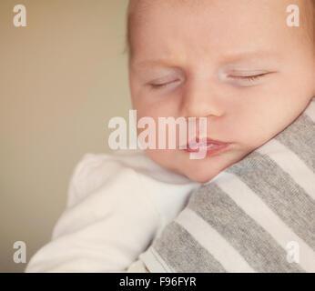 Newborn baby boy is tired and sleepy - Stock Image