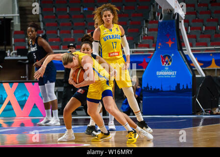 RIGA, LATVIA. 30th of June, 2019. Elin Eldebrink (with ball), during European Women Basketball Championship, commonly called EuroBasket Women 2019 , game between team Sweden and team France in Arena Riga, Riga, Latvia. Credit: Gints Ivuskans/Alamy Live News - Stock Image