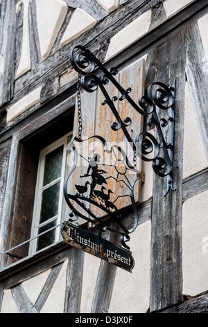 Inn sign L'instant Present in Riquewihr, Haut-Rhin, Alsace, Voges, France. - Stock Image