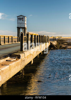 The public causeway linking the island to the mainland with a refuge hut for travellers trapped by the tide. - Stock Image