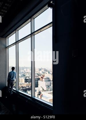 Business Man overlooking New York City - Stock Image