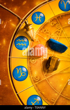 esoteric objects, pendulum and astrology wheel - Stock Image