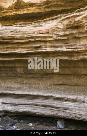 No graffiti sign with graffiti on the cliffs, Ol Njorowa gorge, Hells Gate National Park, Kenya - Stock Image