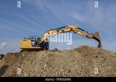 Caterpillar 323e Hydraulic Excavator on a construction site - Stock Image
