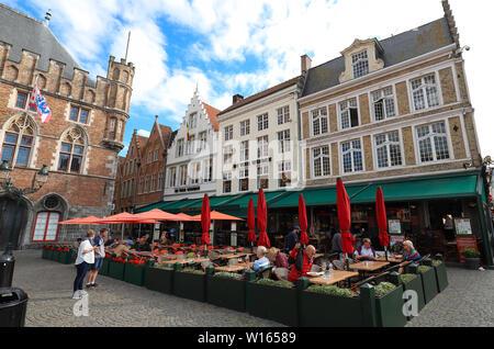 The traditional Flemish cafe De Vier Winden located on Markt of Bruges -Market Square in Bruges , Belgium. - Stock Image
