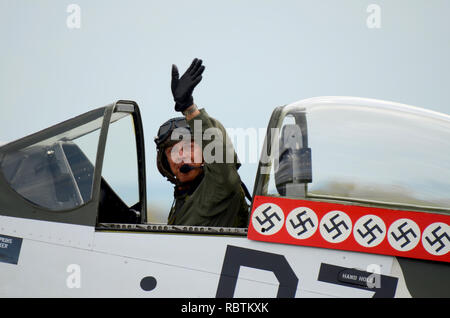 Pilot Alister Kay in cockpit of P-51 Mustang Second World War fighter plane with swastika kill markings - Stock Image