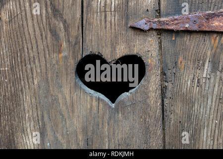 Heart shape on an old door. - Stock Image
