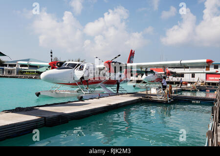 A Trans Maldivian Airways seaplane at its berth , Male Seaplane airport, Male, the Maldives, Asia - Stock Image