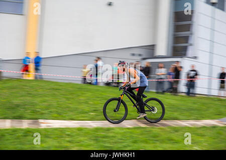 Bielsko-Biala, Poland. 12th Aug, 2017. International automotive trade fairs - MotoShow Bielsko-Biala. Cyclist riding on a wood pavement. Credit: Lukasz Obermann/Alamy Live News - Stock Image