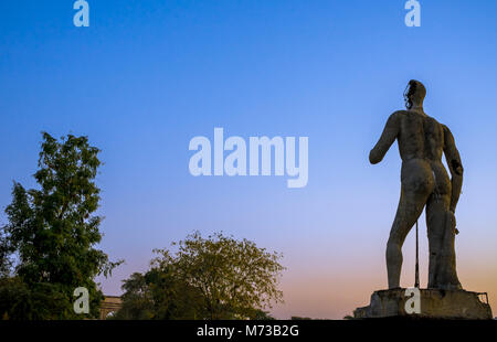 Statue of man at deserted township captured in India. - Stock Image