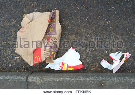 Typical litter found on the streets - McDonald's fast food cartons/wrapping. North Woolwich, London, UK. - Stock Image