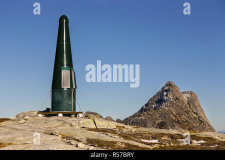 Green UHF / VHF Radio Repeater Tower at Flatiron Mountain Top with Needle Peak of Coquihalla in the Background - Stock Image
