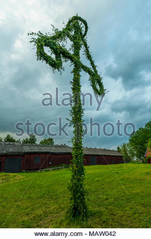 Midsummer Sweden, magic midsummer!Summer solistice used to be a pagan holiday in Sweden, but now it is a celebration of light, maypole and food. - Stock Image
