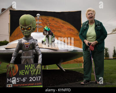 "Sue Morris and her dog ""Pepper"" are seen with a model of a spacecraft and alien used for photos - Stock Image"