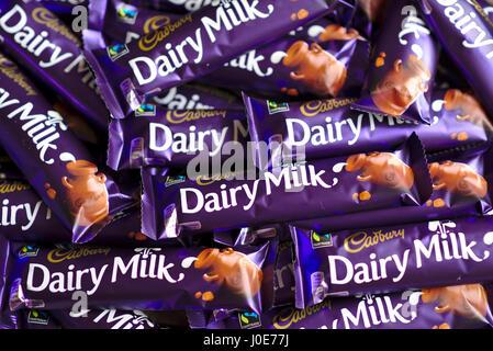 Cadbury's Dairy Milk bars in a pile - Stock Image