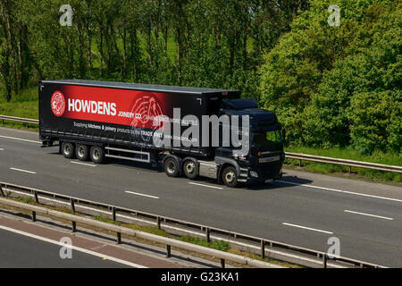 Howdens Joinery HGV travelling on the M56 motorway in Cheshire UK - Stock Image