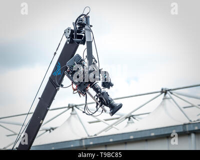 TV Broadcast camera on large boom at outside broadcast - Stock Image