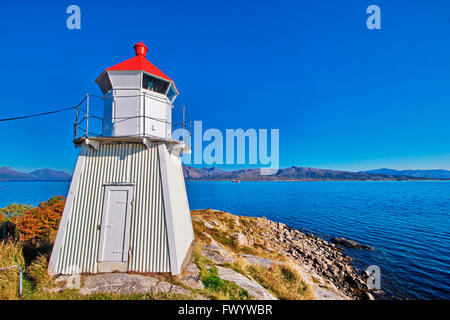 Lighthouse in Lødingen on island Hinnøya in northern Norway on a sunny day - Stock Image